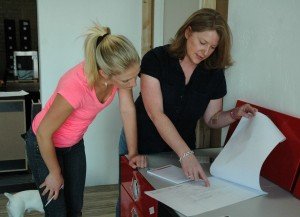 Lauren and Cindy go over the plans for one of the new displays. Oh, and that's Jackson supervising from the back.